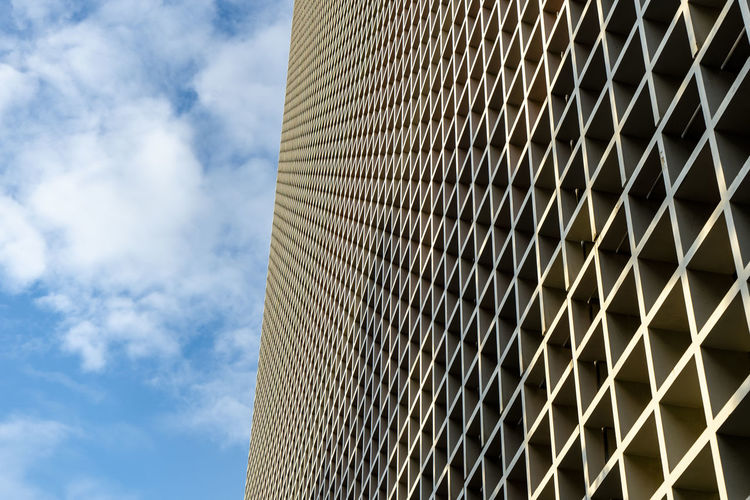 urban architectural facade design space with sky space Architectural Feature Sunlight Outdoors Office Building Exterior Modern No People Day Nature Building Exterior Building Architecture Cloud - Sky Low Angle View Sky Office Tall - High Built Structure Pattern City Skyscraper