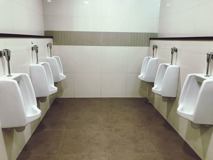 Indoors  Urinal Bathroom Hygiene No People Public Restroom Tile Convenience Neat Day Flushing Toilet