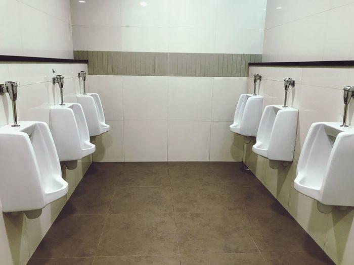Urinals at public restroom