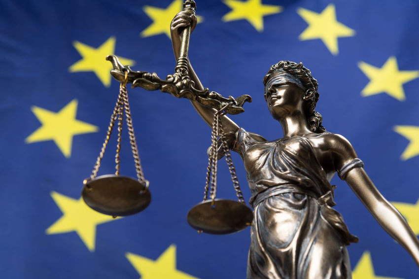 Statue of the blindfolded goddess of justice Themis or Justitia, against an European flag, as a legal concept Authority Court Decisions Democracy European Union Lady Justice Politics Rules Concept Courthouse Eu Europe Flag Gavel Goddess Judge Judgement Justice Law Legal Legislation Order Sculpture Statue Symbol