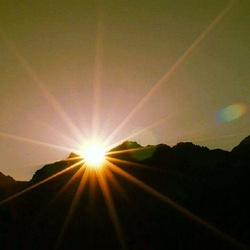 A star or the setting sun Sunsetbehinountain Sun Mountain Kelvin star orange instagood dusk evening picoftheday landscape endofday