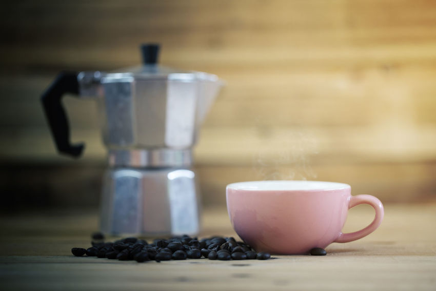 Pink cup of coffee with wood background Moka Pot Berry Fruit Breakfast Close-up Coffee Coffee - Drink Coffee Cup Cup Drink Focus On Foreground Food Food And Drink Freshness Healthy Eating Hot Drink Indoors  Mug No People Pitcher - Jug Refreshment Still Life Table