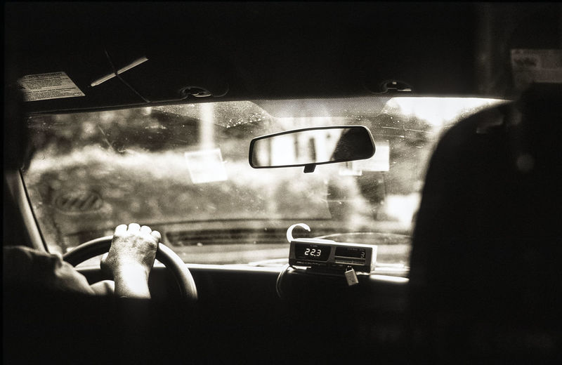 Rear view of person driving car