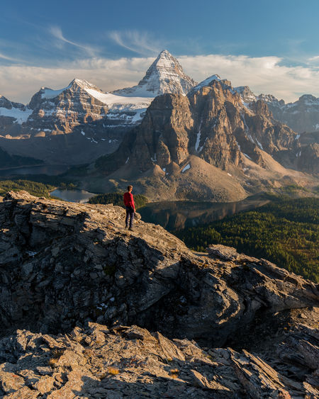 """The world is big and I want to have a good look at it before it gets dark."" John Muir One of the more amazing places I have seen lately. Taken at sunset after scrambling up the ridge to Nub Peak (2,755 m or 9,039 ft). I like the perspective up here as Mount Assiniboine (3,618m or 11,870ft) rightfully towers over Sunburst Peak in the foreground which you don't appreciate at the nublet far below. Mount Assiniboine Provincial Park, British Columbia, Canada . Love Life, Love Photography Assiniboine Provincial Park British Columbia, Canada Craggy Nub Peak Sunburst Peak Activity Adventure Beauty In Nature Cloud - Sky Environment Formation Hiking Men Mountain Mountain Peak Mountain Range Nature Non-urban Scene One Person Outdoors Real People Ridgeline Scenics - Nature Sky The Nub"
