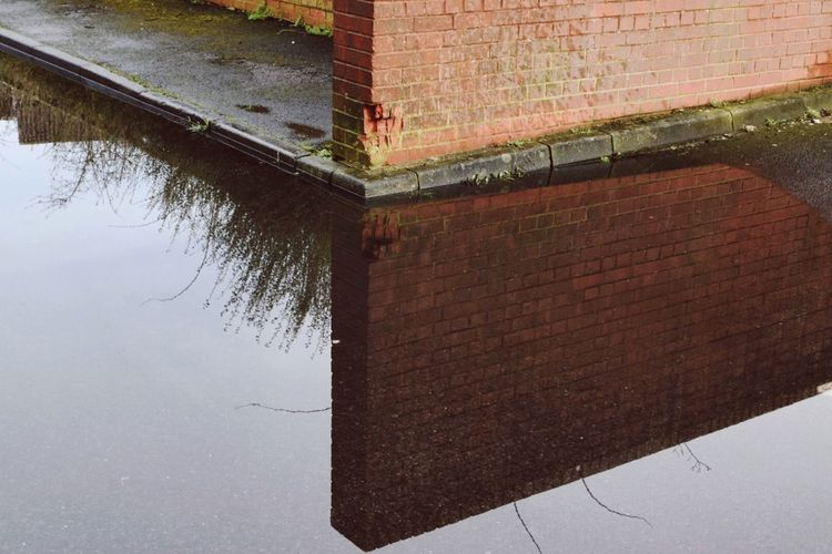 Built Structure No People Architecture Outdoors Wall Brick Wall Eye4photography  Taking Photos EyeEm Gallery Streetphotography Urban Urban Geometry Minimalism Creativity Puddleography Puddle Reflection Water Urban Exploration Wall - Building Feature