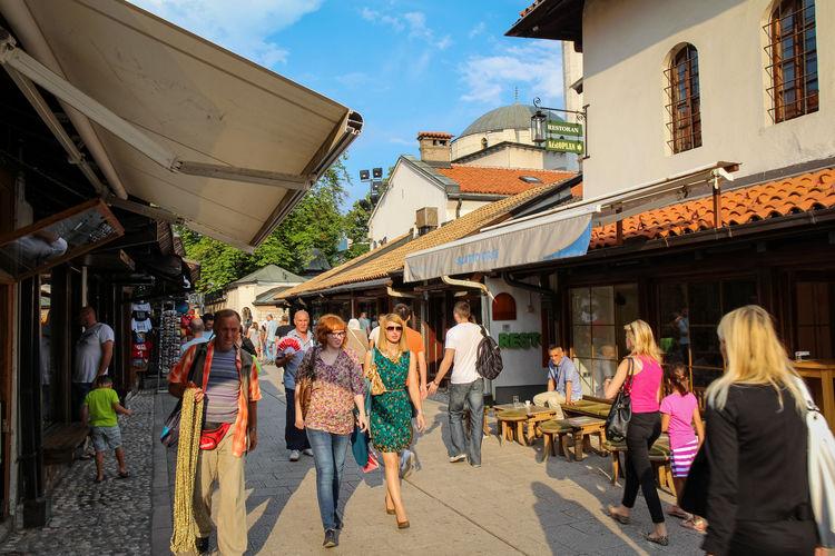 People walking on street market in city