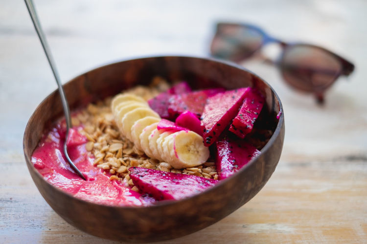 Healthy food is presented and ready to enjoy. Bowl Table Food And Drink Freshness Food Close-up Healthy Eating Indoors  Pink Color Wellbeing Fruit Wood - Material No People Still Life Focus On Foreground Selective Focus Day Seed Ready-to-eat Breakfast Smoothiebowl Smoothie Bowl