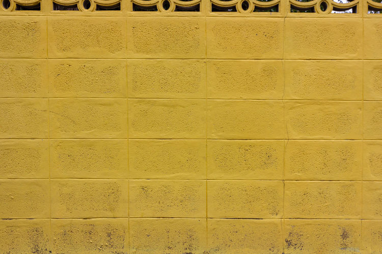 Old yellow concrete block wall ,use for background Yellow Pattern Backgrounds Tile Wall - Building Feature Built Structure Flooring Textured  Full Frame No People Architecture Indoors  Repetition In A Row Design Wall Beige Close-up Shape Side By Side Tiled Floor