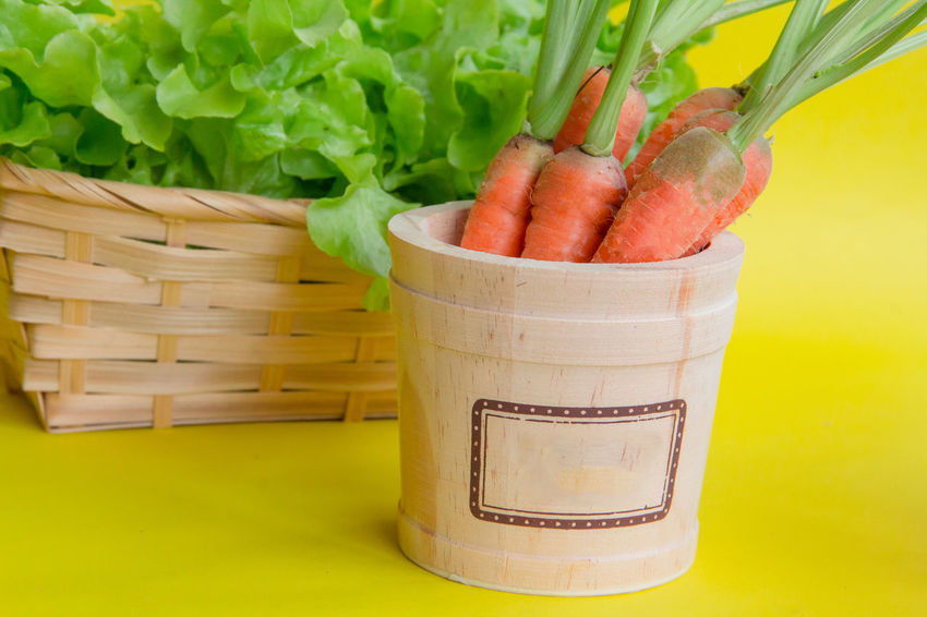 fresh and organic baby carrot, green oak, red oak, vegetables in the bucket and wicker basket for salad Salad Vegetable Vegetables Vegetarian Food Vegetarian Freshness Healthy Eating Food And Drink Wellbeing Container Basket Food Green Color No People Yellow Indoors  Raw Food Plant Carrot Baby Carrots Text Product Mock Up Wicker Basket Orange Color