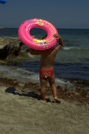 Everything was bigger and colorfulSummer Young Men Rubber Ring Colorful Colors Child Photography Games Sand Childhood Beach Photographic Memory Sea Holiday Muscle 💪💪 Kids Kids Playing Hercules Summertime Puglia Italy Youth Of Today