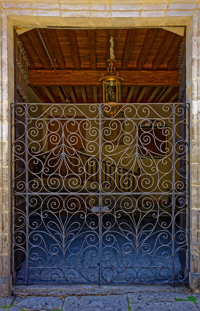 Entrance to a older home in Santillana de Mar, Cantabria Cantabria Entrance Gate Architectural Detail Architectural Feature Doorway House Iron Work Santillana Del Mar