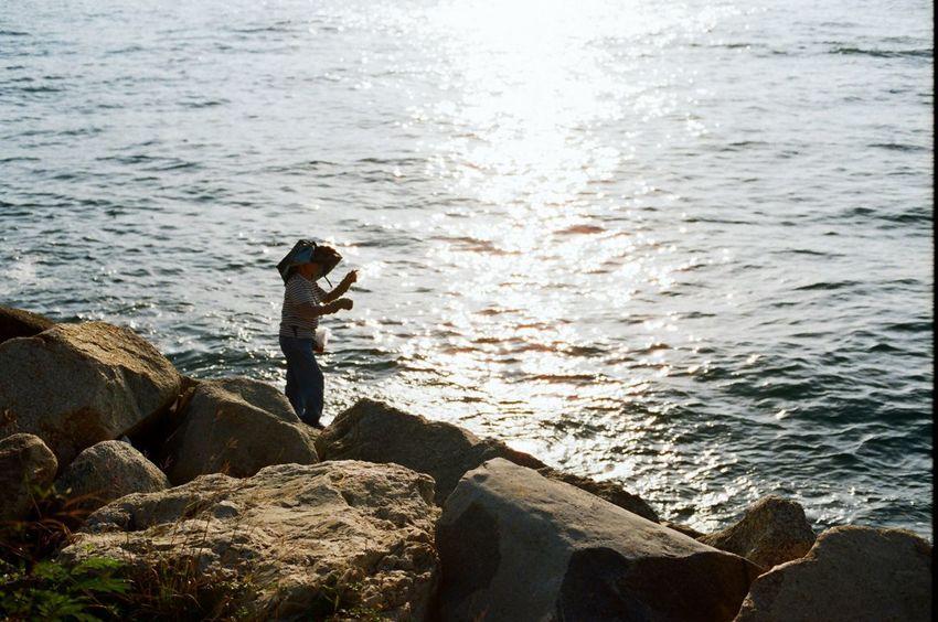 Fishing at the shore Sea Standing Outdoors One Person Fishing Old Woman Sunlight Film Film Photography Nikon Fm2 Kodak Kodak Ultramax 400
