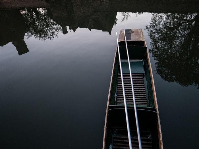 Low angle view of ladder by lake against sky