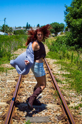 Portrait of woman on railroad track