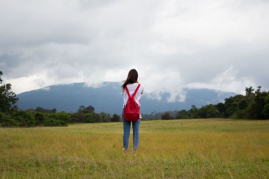 Cloud - Sky One Person Only Women Tree Field Full Length One Woman Only Nature People Sky Adult Rural Scene Young Adult Standing Outdoors Casual Clothing One Young Woman Only Day Young Women Adults Only Lost In The Landscape Kaoyai Travel Photography Thailand Thailand_allshots_nature