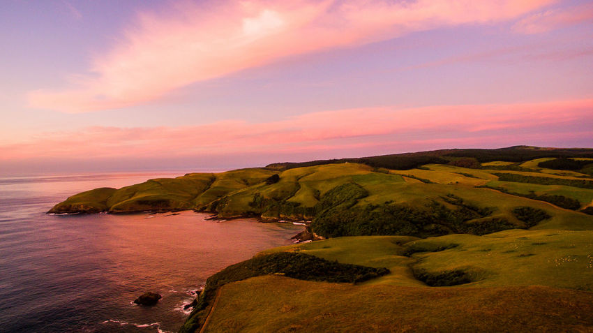 aerial drone shot over new zealand with water Drone  Aerial Photography Beach Beauty In Nature Cloud - Sky Horizon Horizon Over Water Idyllic Land Landscape Nature No People Non-urban Scene Outdoors Rock Scenics - Nature Sea Sky Sunset Tranquil Scene Tranquility Vanlife Water