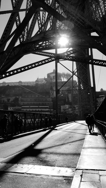 Full Length Sunlight Built Structure Only Men Bridge - Man Made Structure Real People People Adults Only Architecture Sky Outdoors Shadow Transportation Silhouette City Adult Day Lifestyles Black And White Friday Black & White Photography Ponte Luis I Porto Portugal 🇵🇹