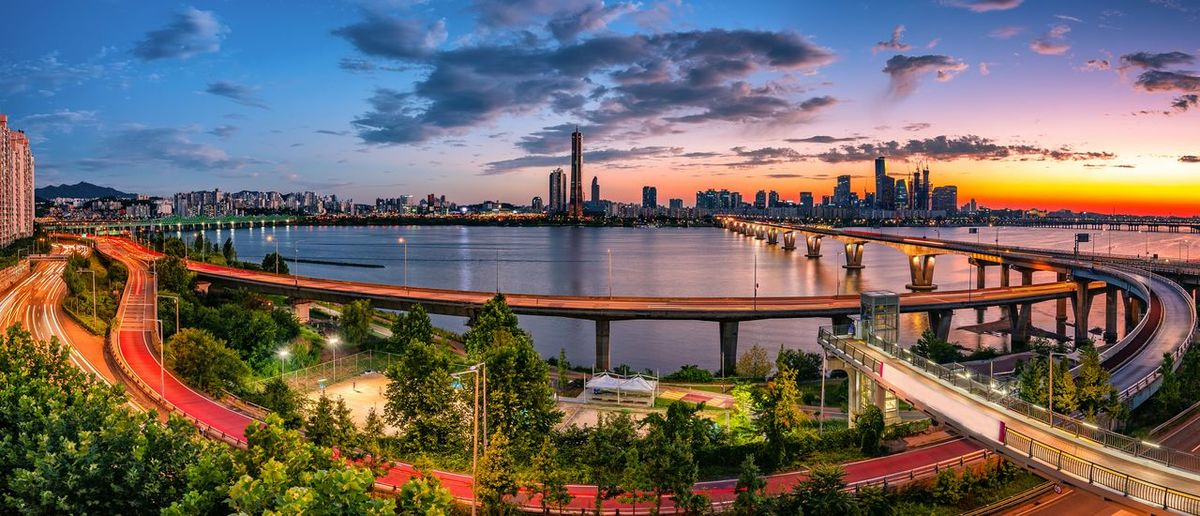 Panoramic view of bridge over river against sky during sunset
