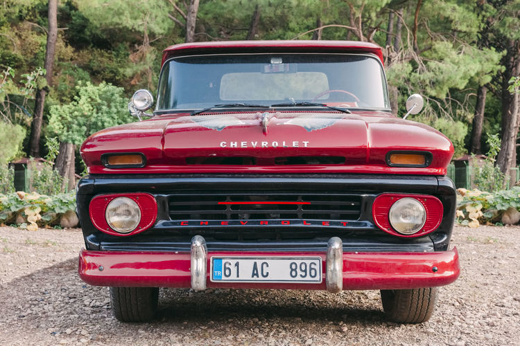 Front view of red Chevrolet pick-up truck in Olympos, Turkey 1950s America Apache Black Car Chevrolet Classic Culture Design Front Front View General Motors  Gm  Grille Headlight History Lot Luxury Motor North Nostalgia Number Number Plate Old Outdoors Park Parking Past Pick-up Pickup Red Retro Sign Stationary Status Street Style Text Transportation Travel Truck Turkey Unpaved USA Vehicle Vintage Wealth Windshield Vintage Car No People