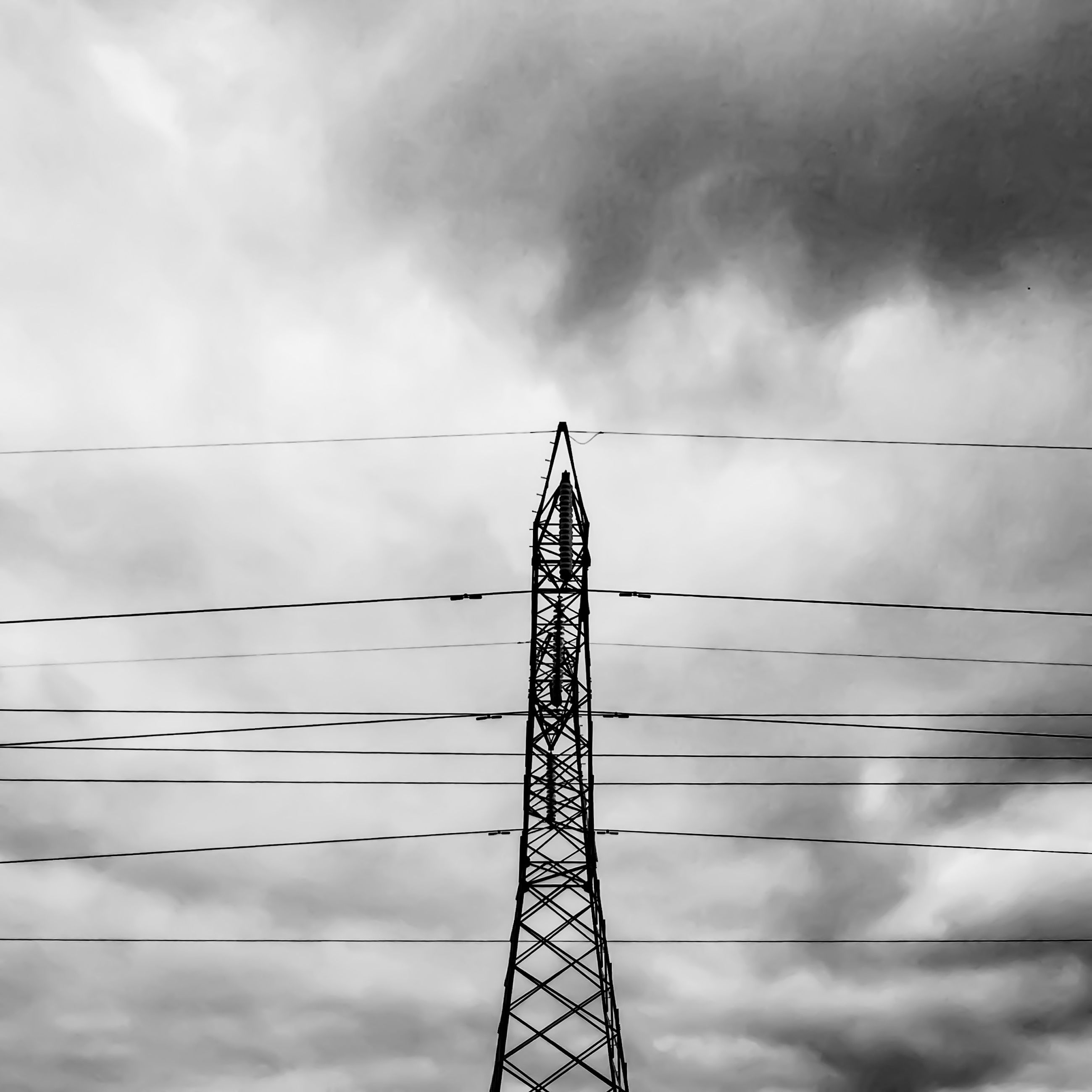 low angle view, sky, cloud - sky, cloudy, electricity pylon, connection, power supply, technology, power line, electricity, fuel and power generation, built structure, metal, tall - high, cloud, architecture, cable, development, construction site, silhouette