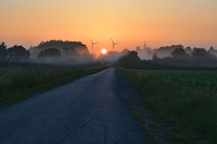 Beauty In Nature Direction Environment Field Land Landscape Nature No People Orange Color Outdoors Plant Road Scenics - Nature Sky Sun Sunset The Way Forward Tranquil Scene Tranquility Transportation Tree