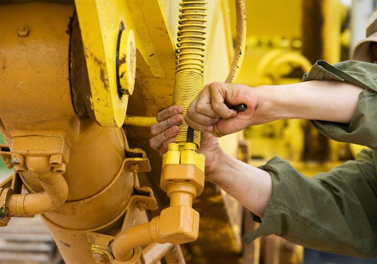 Mechanic Heavy Equipment Tractor Love Yellow People At Work Strong Hands At Work Best Of EyeEm Man At Work Tractors Tractors Among Us Bestoftheday EyeEm Best Shots Eye4photography