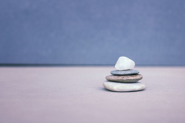 Close-up of stone stack on table