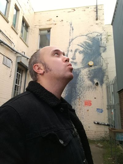 Banksy Banksyart Banksy, Thegirlwiththepiercedeardrum Men Architecture Outdoors City Day