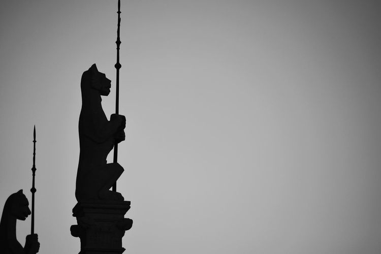 Vigilance EyeEm Best Shots TheMinimals (less Edit Juxt Photography) Silhouette Holding From My Point Of View Architecture Budapest Sculpture History Statue Detail Culture Light And Shadow Travel Destinations Monochrome Blackandwhite Cat EyeEm Best Shots - Black + White Spear