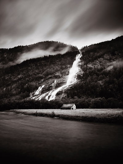 A lonely cabin photographed with long shutter speed to create a dark and moody sky. Adventure Black Blackandwhite Bw Cabin Dark Field House Landscape Longshutter Moody Nature Norge Norway Outdoors Travel Waterfall White