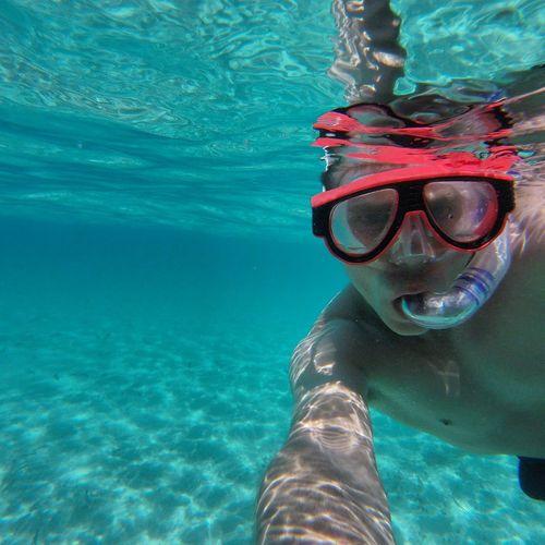 Portrait of mid adult man snorkeling undersea