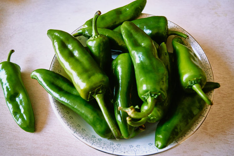 High angle view of green chili pepper on table