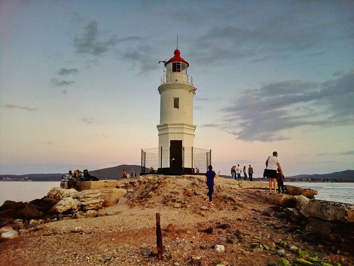 Tokarevskiy lighthouse against the evening sky Beach Sand Sea Sky Cloud - Sky Horizon Over Water Vacations Tranquility People Architecture Outdoors Water Lighthouse Tokarevsky Tokarevskiy Popular Place