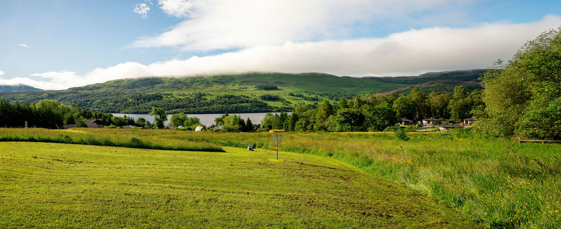 A view of Loch Tay lake from disc golf course in central Scotland, Great Britain Family Golf Loch Tay Nature Perthshire Scotland Tourist Attraction  Activity Basket Cloud - Sky Course Disc Fairway Flying Hill Hole Lake Lake View Landscape Scottish Highlands Sports Summer Travel Destination Travel Destinations