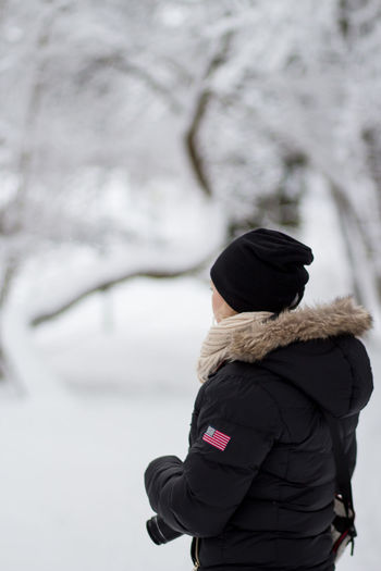 Hat One Person Only Shades Of Winter Beauty In Nature Close-up Cold Temperature Day Focus On Foreground Hooded Shirt Jacket Leisure Activity Lifestyles Nature Outdoors Overcoat People Real People Rear View Snow Standing Warm Clothing Winter Women