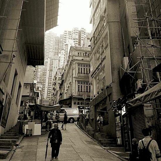 Senior man in HK. Urbanphotography Urbanexploration Hong Kong Travel Destinations Real People People Outdoors EyeEmNewHere Be. Ready. Гонконг Black And White Friday Perfect Shot Travel Guide Travel Desinations чернобелое Monochrome Photography черно-белое фото азия AI Now EyeEm Ready