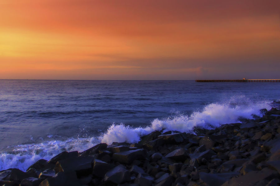 scenic view of sea against sky at sunrise Beach Beauty In Nature Day Dramatic Sky EyeEm Best Shots Horizon Over Water India Landscape Nature No People Outdoors Pondicherrybeach Puducherry Sea Rock Waves Romantic Sky Scenics Sea Seascape Sky Sunrise Sunset Travel Travel Destinations Water Wave