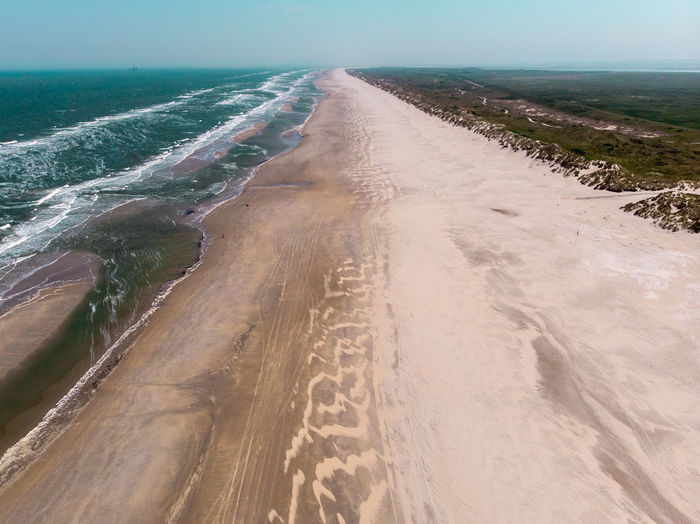 Sea Land Water Nature Day Beach Sand Horizon Beauty In Nature Tranquil Scene Tranquility Scenics - Nature No People Horizon Over Water Sky Motion Outdoors Direction Aquatic Sport Drone  Dronephotography Drone Photography Aerial View Aerial Shot