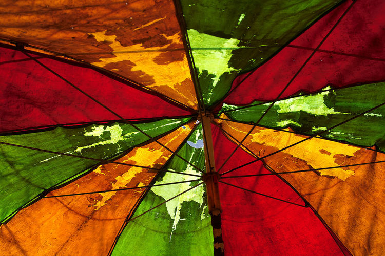 Backgrounds Close-up Day Fruit Stall Shelter Low Angle View Multi Colored No People Outdoors Protection Red Shelter Weathered Umbrella