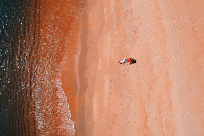Adventure Beauty In Nature Day Desert Land Leisure Activity Lifestyles Nature Orange Color Outdoors People Real People Rock Formation Scenics - Nature Tranquility Travel Unrecognizable Person Water
