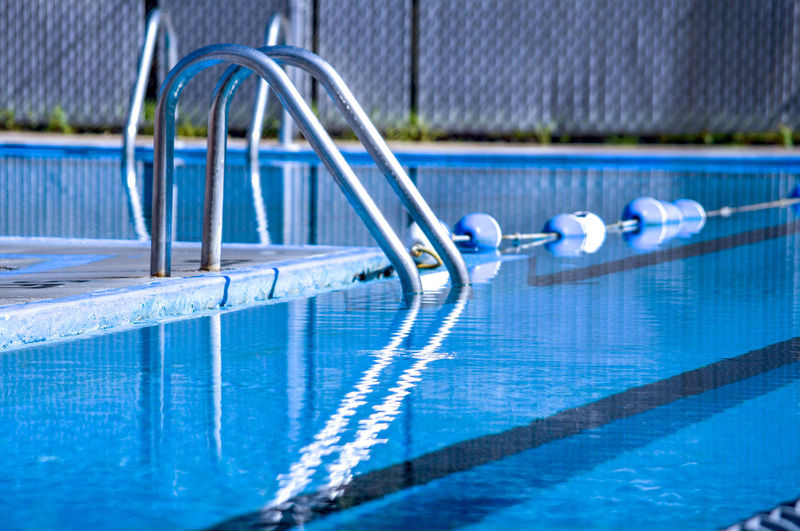Ladder into a crystal blue pool invites one in to take a swim