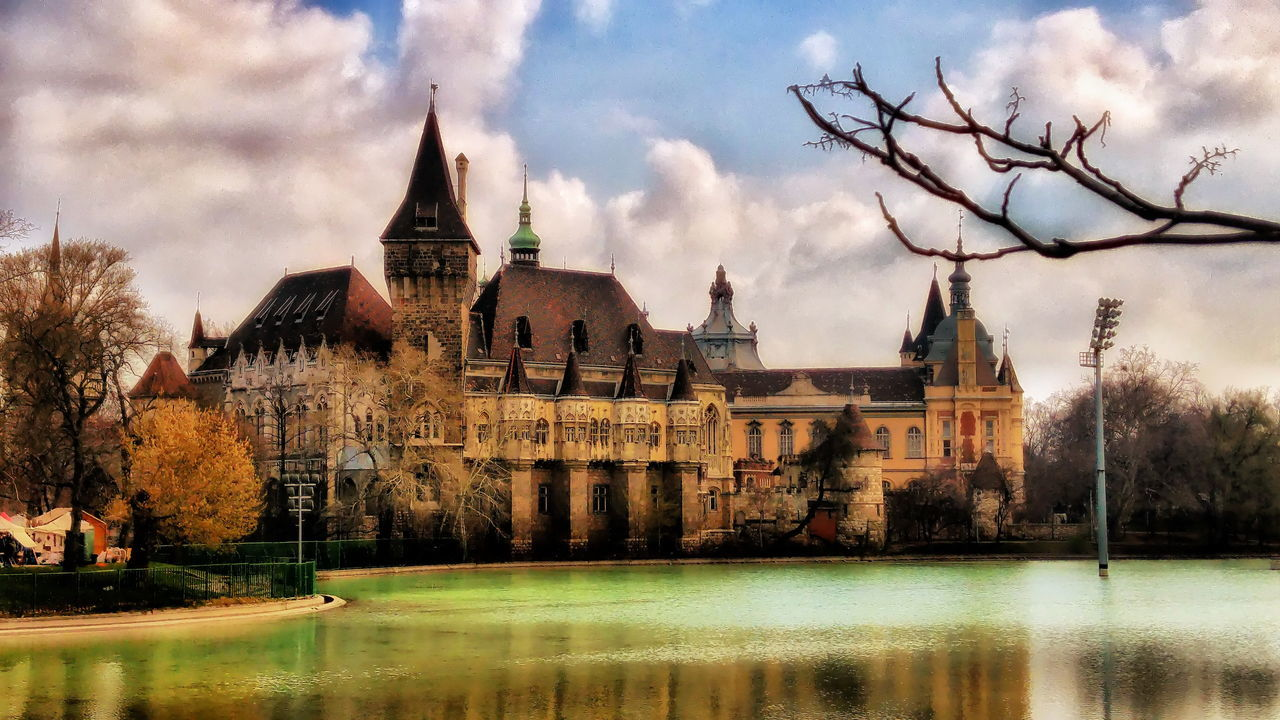 architecture, water, sky, building exterior, tree, built structure, history, river, castle, waterfront, no people, cloud - sky, outdoors, nature, bare tree, travel destinations, day