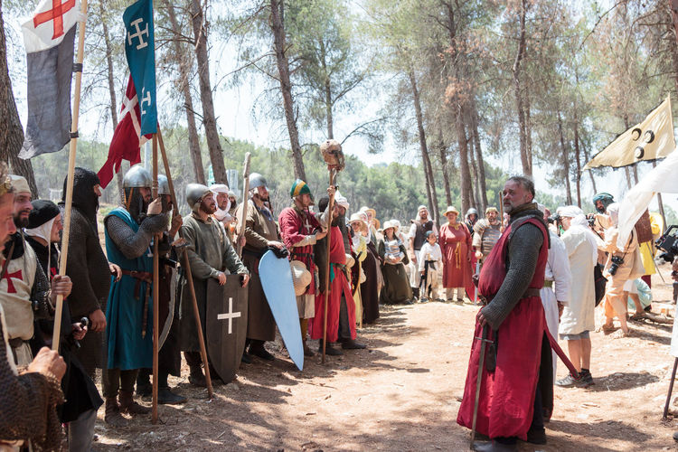 Tiberias, Israel, July 01, 2017 : Participants in the reconstruction of Horns of Hattin battle in 1187 stand in a line in the camp before the campaign near TIberias, Israel 1187 Battle Cross Crusaders Day Field Guy De Lusignan Hattin Heat Heritage History Horn Israel Jerusalem KINGDOM Muslims Outdoors Palestine People Reconstruction Religion Saladin Templars War Weapons