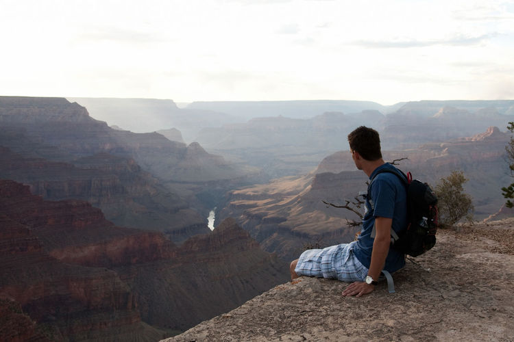 Man sitting on the edge of grand canyon