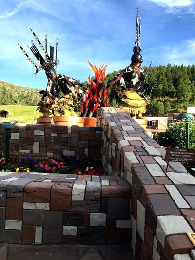 Crown Dancers Inn Of The Mountain Gods Ruidoso, NM Mescalero Apache Sculpture Flowers Blue Sky