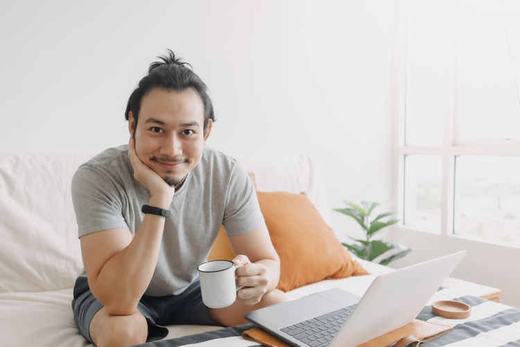 Portrait of smiling man sitting at home