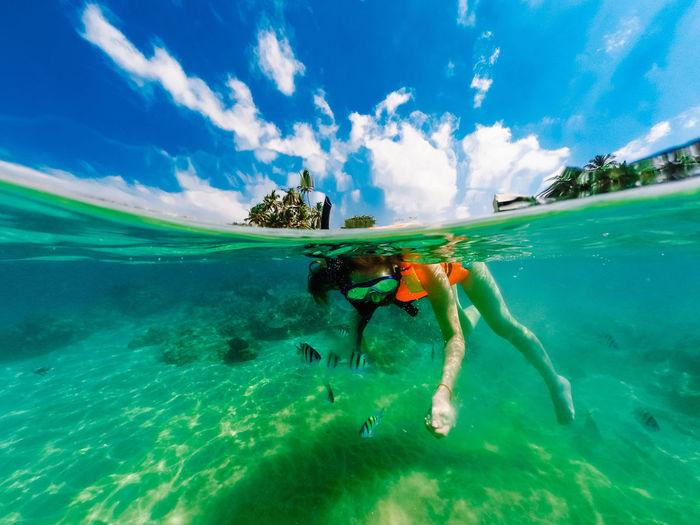 People swimming in sea. dom gopro case . underwater sri-lanka