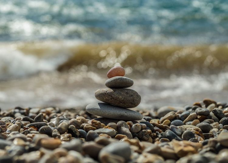 Pebble Stone - Object Stack Balance Large Group Of Objects Beach Abundance Rock - Object Stone Zen-like Surface Level Group Of Objects Focus On Foreground Travel Destinations Day Tourism Smooth Pyramid Shape Pebble Beach Nature Bokeh Bokeh Photography Bokehlicious Sea Surf
