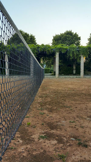 Arbor Clay Court Close View Concrete Pillars Pergola Pillars Symmetry Tennis Tennis Court Tennis Net Trees Trees And Sky