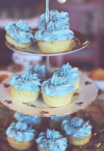Close-Up Of Blue Cupcakes On Cakestand